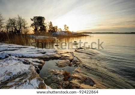 Setting sun in winter (Turku, Finland) - stock photo