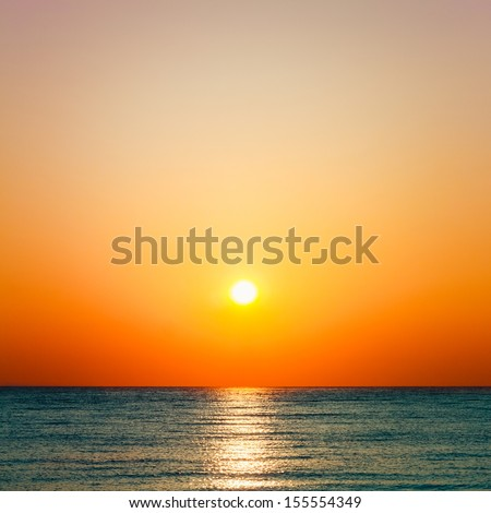 Setting sun on pacific ocean. Beautiful sunset, sunrise sea horizon - stock photo