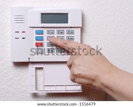 Setting the Alarm System (Horizontal/Landscape) - stock photo