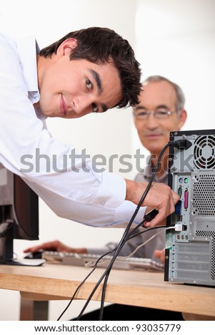 Setting up computer - stock photo