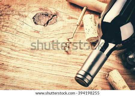 Setting with bottle of red wine and corks. Wine list concept with copy space