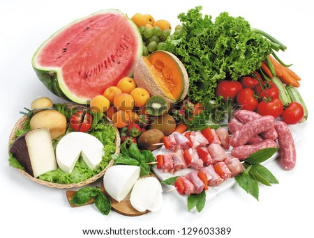 Setting with meat, fruit, vegetables and cheese