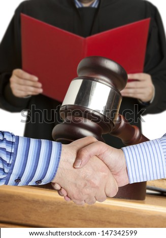 Settlement agreement against the background of judge - stock photo