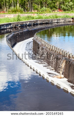 Settlers on sewage treatment plant - stock photo