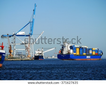 Setubal, Portugal, 16th April 2013, Container terminal and ship maneuvers in port. - stock photo