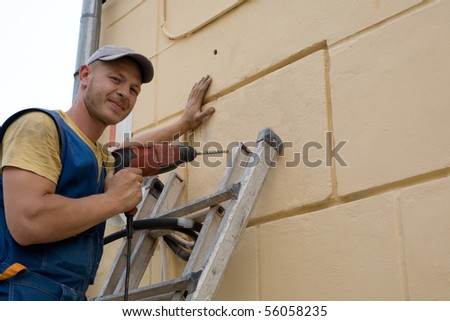 Setup man performs work on installing a new air conditioner. - stock photo