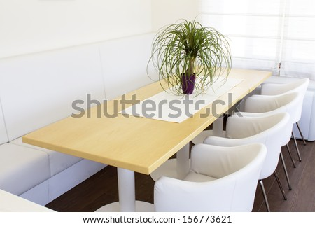 Setup of the business table with white chairs. - stock photo