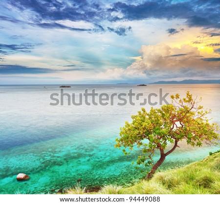 Seunset over the sea. Komodo national park - stock photo