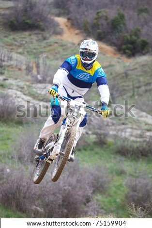 "SEVASTIPOL, UKRAINE - APRIL 10: Racer Roman Chuikov on competition of mountain bike ""Fort Balaklava 2011"" on April 10, 2011 in Sevastopol, Ukraine - stock photo"