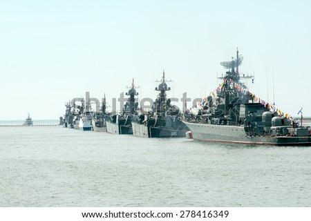 SEVASTOPOL, CRIMEA - MAY 9: Parade of the Russian warships celebrating Victory Day on May 9th, 2014. Russian Navy fleet in the Sevastopol Bay, Crimea - stock photo