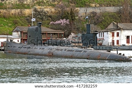 "SEVASTOPOL, RUSSIA - MARCH, 2016: Russian Navy project 641 Foxtrot class ""Zaporozhiye"" submarine moored to the pier at Sevastopol bay"