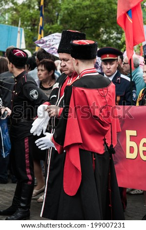 SEVASTOPOL, RUSSIA - MAY 09: Celebrating the 69th anniversary of the Victory Day and 70th anniversary of Sevastopol liberation from fascists. Sevastopol 2014. Parade, Cossacks.  - stock photo