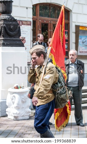 SEVASTOPOL, RUSSIA - MAY 09: Celebrating the 69th anniversary of the Victory Day (WWII) and 70th anniversary of Sevastopol liberation from fascists..Sevastopol 2014. Parade,man with Red Victory Banner - stock photo