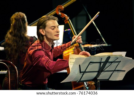 SEVASTOPOL, UKRAINE - APRIL 19: Alina Kabanova (piano) and Fedor Elesin (cello) from the group Beethoven Duo perform at the festival South Window on April 19, 2011 in Sevastopol, Ukraine. - stock photo