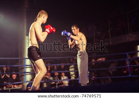 SEVASTOPOL, UKRAINE - APRIL 3: Bazhenov (L) VS Gutosckij (R) at the Ukrainian championship MIX FIGHT on April 03, 2011 in Sevastopol, Ukraine. - stock photo