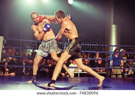 SEVASTOPOL, UKRAINE - 03 APRIL: Ivan Grigoriev Ivan (L) vs Anatoliy Perevyshko (R) at Ukrainian championship MIX FIGHT on April 03, 2011 in Sevastopol, Ukraine. - stock photo