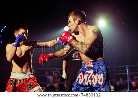 SEVASTOPOL, UKRAINE - 03 APRIL: Yuriy Gromov (L) vs Osman Sirodzhaev (R) at Ukrainian championship MIX FIGHT, April 03, 2011 in Sevastopol, Ukraine. - stock photo