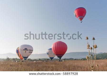 SEVASTOPOL, UKRAINE - AUGUST 12: Balloons flying air over the territory starting in the valley Baydarskaya, International Balloon Festival Montgolfeerie, August 12, 2010 in Sevastopol, Ukraine. - stock photo