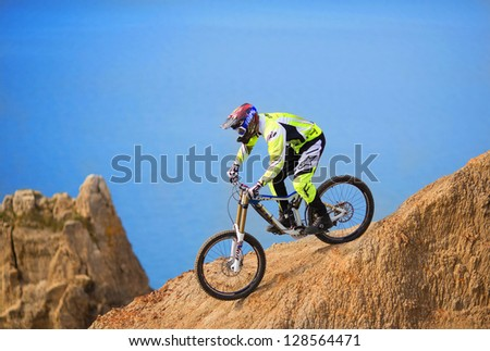 "SEVASTOPOL, UKRAINE - FEBRUARY 13: Unknown racer on the competition of the mountain bike ""FRaction ride 2013"" on February 13, 2013 in Sevastopol, Ukraine"