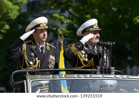 SEVASTOPOL, UKRAINE - MAY 9: Vice admirals Fedotenkov, Russia, left and Ilyin, Ukraine review the troops during military parade in honor of Victory Day in Sevastopol, Crimea, Ukraine on May 9, 2013 - stock photo