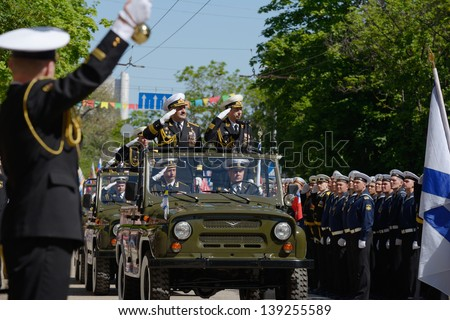 SEVASTOPOL, UKRAINE - MAY 9: Vice admirals Ilyin, Ukraine, left and Fedotenkov, Russia, review the troops during military parade in honor of Victory Day in Sevastopol, Crimea, Ukraine on May 9, 2013