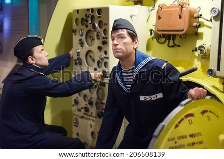 Sevastopol, Ukraine - May 1, 2010: Waxwork of USSR submarine sailors in Balaklava bay naval complex, in the Crimean peninsula near Sevastopol, Ukraine. - stock photo