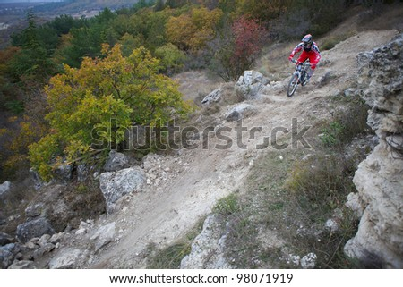"SEVASTOPOL, UKRAINE - NOVEMBER 2: Unknown racer on the training session of the mountain bike event ""Listopad Bike Session 2011"" on November 2, 2011 in Sevastopol, Ukraine - stock photo"
