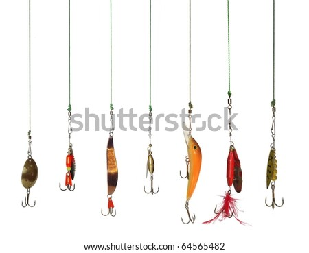 seven artificial angling baits on white background - stock photo