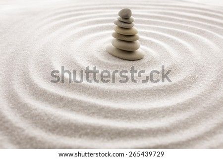 Seven balancing stones. Japanese zen garden meditation for concentration and relaxation sand for harmony and balance in pure simplicity - macro lens shot. - stock photo