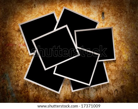 Seven blank  instant photos over wooden background - stock photo