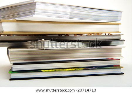 Seven books lying in a pile - stock photo