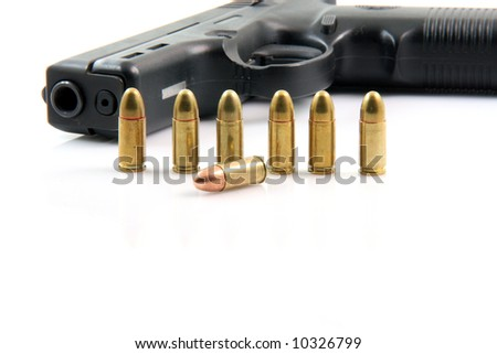 seven bullets and handgun closeup isolated on white background - stock photo