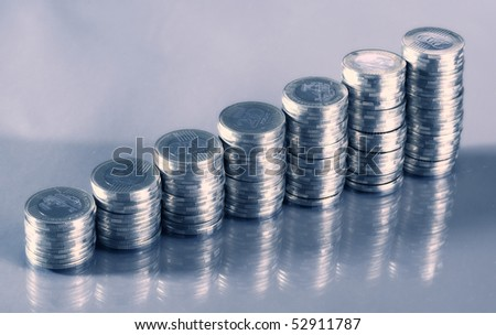Seven coin piles with reflection