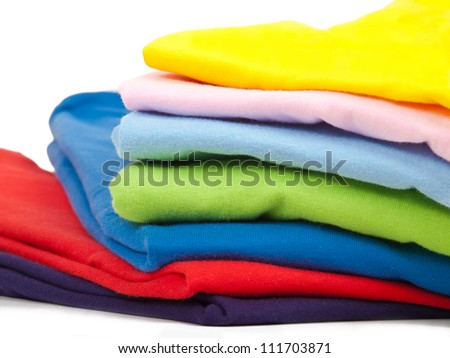 seven colorful t-shirts isolated on white background