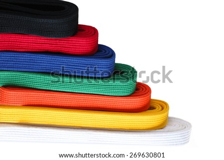 Seven  colors of martial arts Taekwondo belts in order from low to high - stock photo