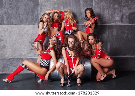 Seven Cute go-go sexy girls in red racing costume