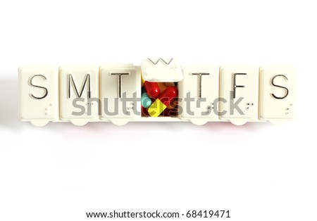 seven day pill box showing Wednesday pills isolated on white background - stock photo
