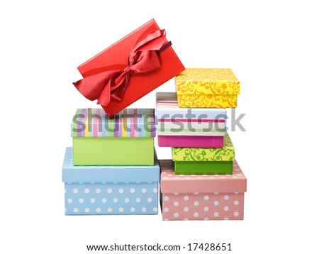 seven different gift boxes stacked, upper one with lanyard, isolated on white