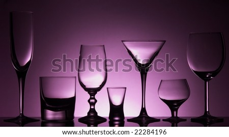 Seven different glasses - stock photo
