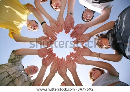 Seven friends have connected hands - stock photo