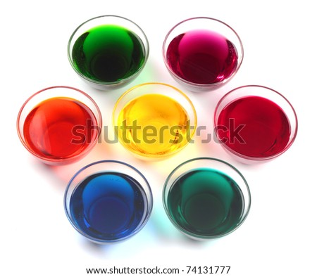 Seven glass caps with dyes for easter eggs isolated on white background - stock photo