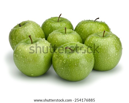 Seven green apples isolated on white