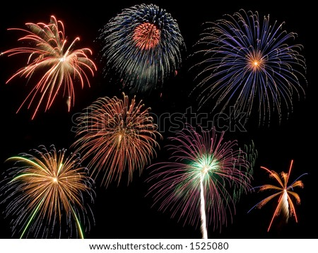 Seven individual firework bursts were combined in a single colorful image. - stock photo