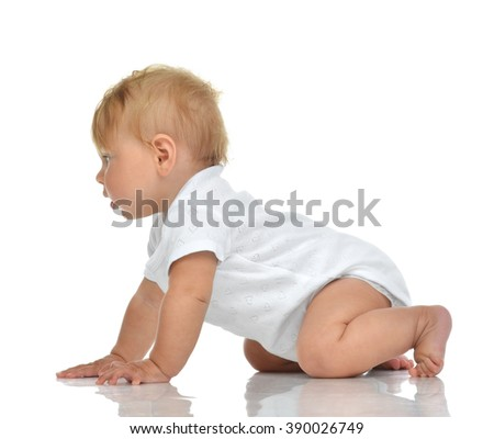 Seven month infant child baby girl toddler crawling looking at the corner isolated on a white background