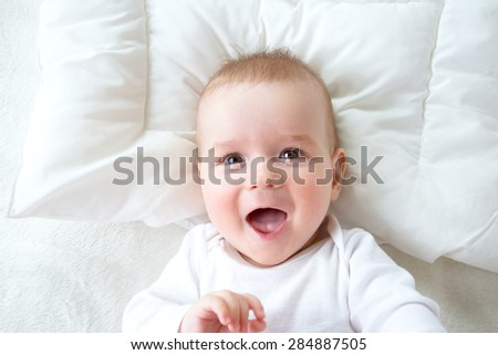seven month old boy in the bed - stock photo