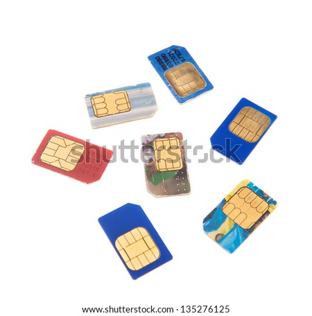seven old used gsm sim-cards isolated - stock photo