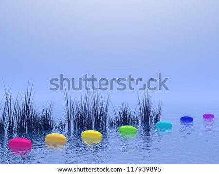 Seven pebbles with chakras colors upon the deep blue ocean and in front of vegetation - stock photo