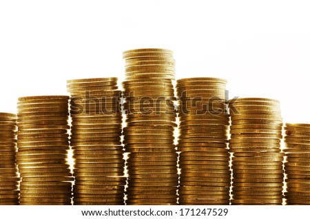 Seven piles of gold coins on a white background - stock photo