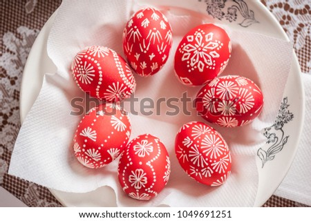 Seven Red Easter Eggs In A Plate. Close Up, Soft Focus, Painted With