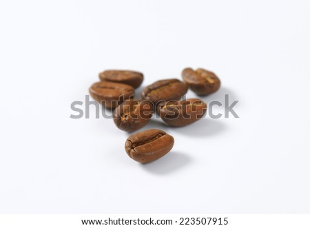 seven selected coffee beans focused - stock photo